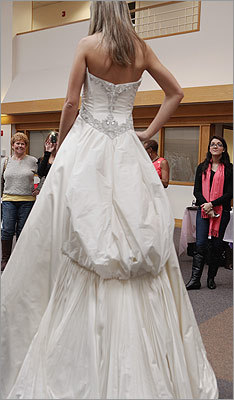 Stefania Giangregorio of Waltham, who is planning a July 2013 wedding, modeled her dress.
