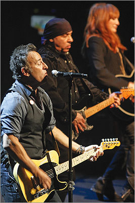 Springsteen (left) also performed with his E Street Band, including Steven Van Zandt and his wife, Patti Scialfa.