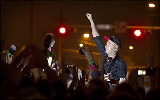 Musician and activist Tom Morello, formerly of Rage Against the Machine, led a group of Occupy protesters at a rally in downtown Austin after his performance at South by Southwest.