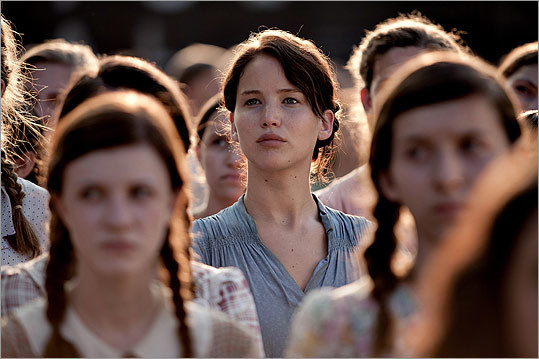 In ' The Hunger Games ,' Katniss Everdeen (Jennifer Lawrence) volunteers to take her sister's place in the nationally televised killing games of the title. The film enters into the tradition of movies centering around fights to the death ...