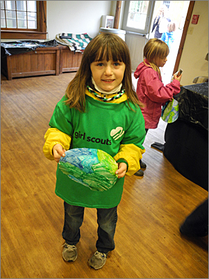 Kate Anderson-Strain, 6, of Cambridge, colored the Earth at one of the activity booths.