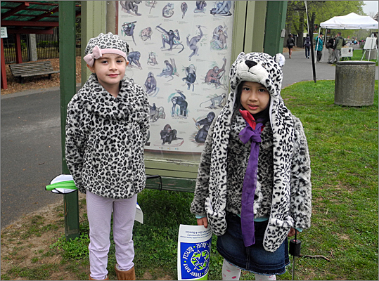 From left: Sophia Salah, 8, and her neighbor Saoirse Beare, 7, of Dorchester wore matching leopard print outfits to the Zoo. Salah and her mom are Franklin Park Zoo members who go there about three times a week in the summer. Salah said she's so excited for the zoo's 100th birthday that she's writing a picture book about the zoo called, 'I see Who.'