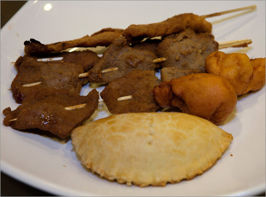 The 'Suya Joint sampler' dish (pictured) consists of beef and chicken 'suyas', which are Nigerian kebabs, a meat pie, and black-eyed pea fritters known as akaras.