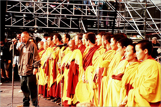 A practicing Buddhist, Yauch co-organized the Tibetan Freedom Concert. In this still from the 1998 film 'Free Tibet,' Yauch poses with Tibetan monks and nuns at the Tibetan Freedom Concert in 1996.