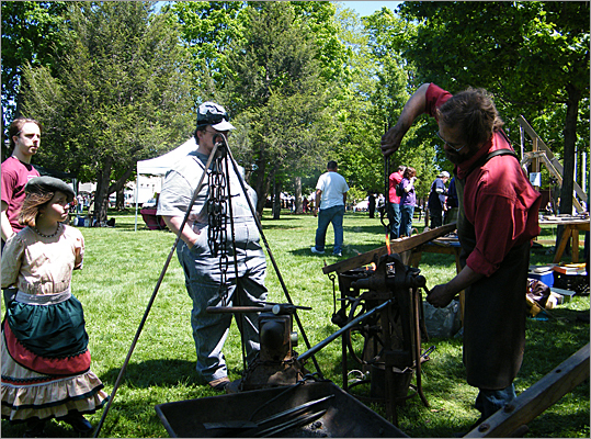 A blacksmith, one of nearly 50 vendors that will attend the festival this weekend, conducted a demonstration for steampunk passersby.