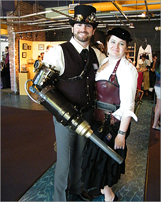 "Elizabeth and Christopher Paolella, 33 and 35 respectively, drove from Coventry, Rhode Island to show off their steampunk innovations – Christopher showcased his mechanical arm cannon, assuring admirers that it was not fully functional. ""If it actually worked, my shoulder would be out there on the street,"" he joked."