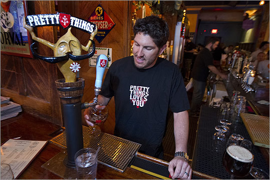 Bartender Ben Kweskin pours a glass of Pretty Things beer at The Publick House in Brookline.