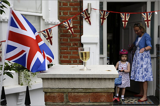 Katherine Burgess and her daughter Charlotte, 3, left their house during a street party to celebrate Queen Elizabeth's Diamond Jubilee at Fulham in London on June 2.
