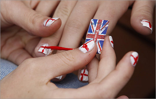 Girls painted their nails in the colors of the St. George's Cross during a street party in celebration of Queen Elizabeth's Diamond Jubilee at Primrose Hill in London on June.