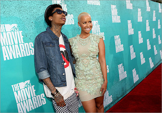 Rapper Wiz Khalifa (left) played it cool with fiancee Amber Rose.