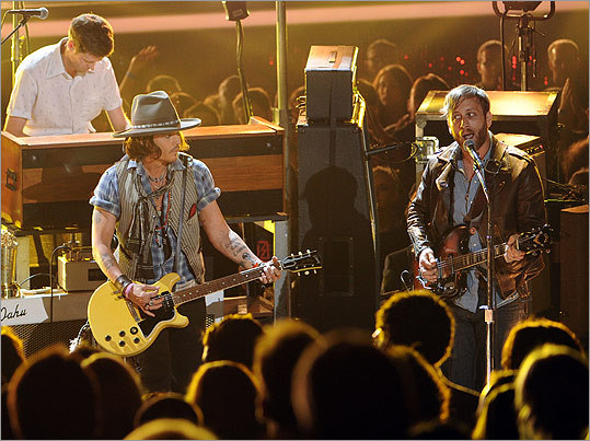 Depp (left) celebrated the award by jamming with Dan Auerbach and the Black Keys on 'Gold on the Ceiling' and 'Lonely Boy.'