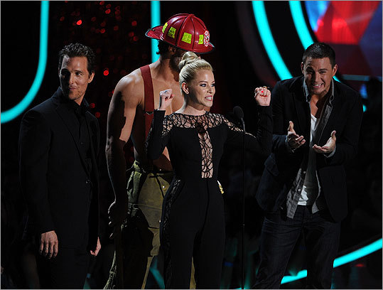 Elizabeth Banks thanked MTV for making this moment happen with manly 'Magic Mike' stars Matthew McConaughey, Joe Manganiello, and Channing Tatum as she accepted the award for best on-screen transformation for 'The Hunger Games.' She apologized to her husband, and then was carried offstage by Manganiello.