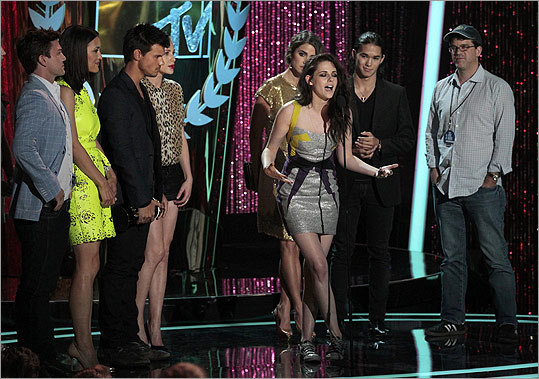 Stewart (center) was back onstage with some back-up later in the night to pick up the show's big award, movie of the year for 'The Twilight Saga: Breaking Dawn Part 1.'