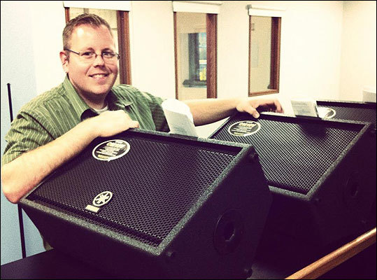On day 13, @therealmikesnow monitors studio progress. Speakers ... check.