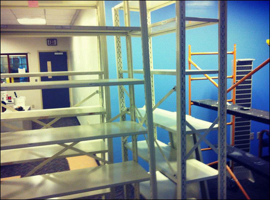 Progress on day number three includes paint and racks ... lots and lots of racks that will hold really cool radio things.