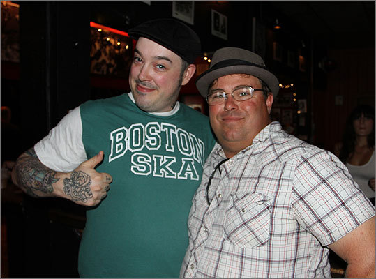 Drew Indingaro (left) of Jamaica Plain and Paul Christian from Boston, both members of local band Cradle to the Grave , were on hand for the event. 'He's great,' said Christian of Turner. 'He's like a young Billy Bragg.'