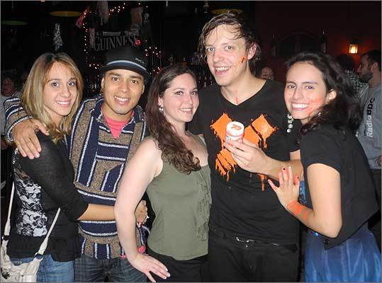 Some attendees gathered with DeLong for a photo opportunity following the intimate performance. They are, left to right, Jennifer Ramos of Somerville, Brazil native Fabrico Dias from Medford, Morgan Fleishman of Brookline, and Evelyn from Somerville.