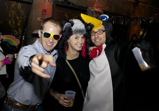 Dan Disciullo of Cambridge, dressed in'80s denim, with Boston residents Veronica Vandoloski, a honey badger, and Jesse Gage, a penguin.