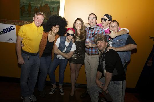 "From left: RadioBDC employees Johnny L of Melrose dressed as Coors Light security, and DJ Julie Kramer as Diana Ross, while Steph Mangan of Boston dressed in '80s denim, Alaina Riccardi of North Reading dresed as a Golden Girl, RadioBDC's Adam 12 of Greenwood dressed as Louis from ""Revenge of the Nerds,"" Brad Mitchell of Newburyport dressed as an '80s vagabond, Mike Snow of Melrose dressed in a ""Love of Denim"" costume, and Boston.com's Chris Rattey of Watertown in an '80s mullet."