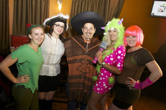 From left: Champions of Boston employees Danielle Cole of Somerville dressed as Peter Pan, Julie Chetkauskas of Somerville as Captain Hook, Vinny Vianna of Somerville, Lydia Merredew of Quincy as an '80s melody monster, and Emma White of Watertown in her 'I am the '80s' costume.