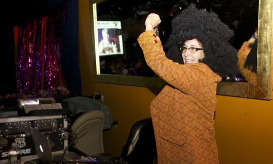 DJ Julie Kramer dressed as Diana Ross.