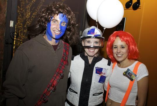 "From left: Medford residents Justin Moscati dressed as Braveheart, Emily Moscati dressed as skydiver Felix Baumgartner, and Christina Murphey of Somerville as Leeloo from the movie ""The Fifth Element."""