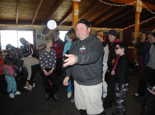 DJ Mike Snow has some fun playing catch with his microphone.