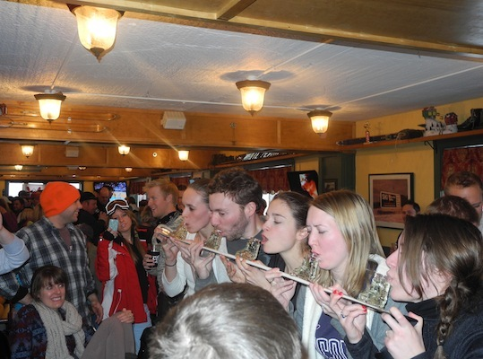 Waterville Valley partiers find a new use for an old ski in an attempt to win RadioBDC giveaways.
