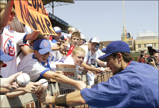Upon arriving at Wrigley Field, newly acquired Cubs shortstop Nomar Garciaparra is deluged with autograph requests from excited fans.