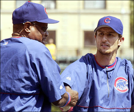 Garciaparra chats with Cubs manager Dusty Baker before his first game as a Cub.
