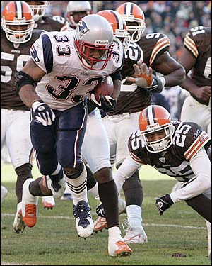 Kevin Faulk runs out of the reach of Browns defender Chris Crocker and rumbles 10 yards for a touchdown during the third quarter.