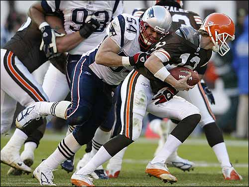 New England linebacker Tedy Bruschi sacks Cleveland quarterback Luke McCown during the third quarter.
