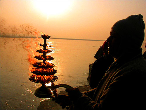 A Hindu offers prayers on the banks of river Sangam in Allahabad for people who perished when a tsunami hit southern India on Sunday.