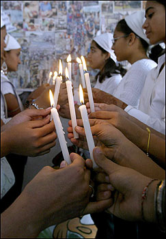 Earthquake victims light candles to pay homage to tsunami victims in the western Indian city of Ahmedabad.