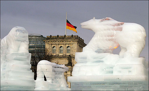 A German flag flying at half-staff flanks Brandenburg Gate, the scene of preparations for New Year festivities in Berlin. Around 1,000 Germans are still missing as a result of the tsunami.
