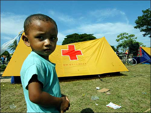An Indonesian child stands in a makeshift camp for displaced survivors in Banda Aceh.