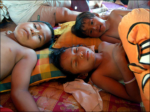 Indonesian children rest in a makeshift refugee camp in Banda Aceh.
