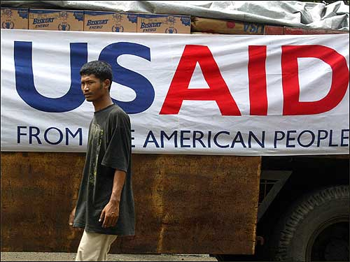 A worker walked by a truck loaded with foodstuff being sent to the devastated province of Aceh.