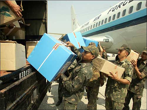 Indian army soldiers loaded relief materials onto their vehicle at the Port Blair airport.