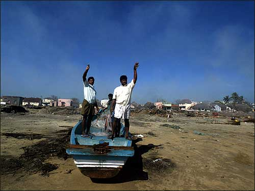 Fishermen wave as they prepare to take their boat out to sea in Nagapattinam, 219 miles south of the Indian city of Madras. Indian fishermen residing in the tsunami-devastated coast of Nagapattinam have started to venture out to the sea again since the tragedy struck last week.