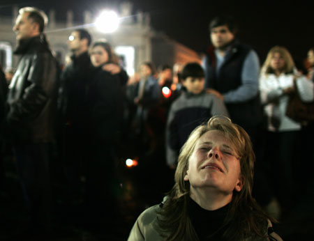 A grief-stricken woman, among those who gathered at the Vatican to keep vigil for the pope in his final hours, reacted to the announcement of his death last night.