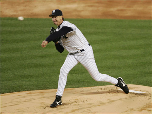 New Yankees ace Randy Johnson throws a pitch in the opening inning of Sunday's game against the Red Sox at Yankee Stadium. Johnson retired the first three batters in order.