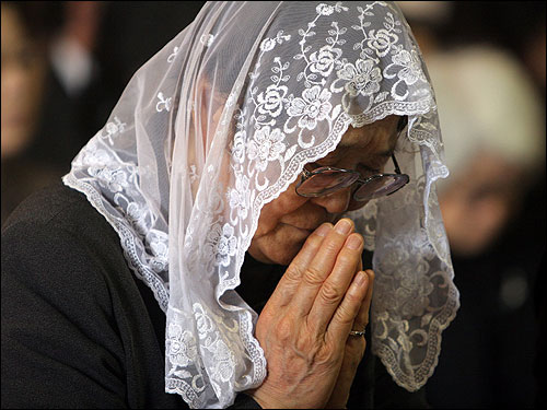 An elderly Japanese Catholic woman prayed during a memorial service for Pope John Paul at St. Mary's Cathedral in Tokyo. While the mainly Buddhist nation stamped out Christianity in the 17th century, it now has about half a million Catholics, who joined millions around the world in remembering the Pope.