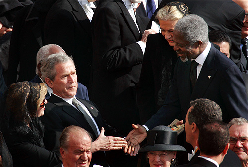 UN Secretary-General Kofi Annan (right) and his wife, Ann, greeted George W. Bush and his wife, Laura, in St. Peter's Square at the start of the funeral for Pope John Paul II.
