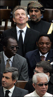 British Prime Minister Tony Blair looked up as he sat with other dignitaries at the funeral.