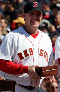 Curt Schilling smiled while holding his World Series ring before the start of the Red Sox' home opener against the New York Yankees at Fenway Park.