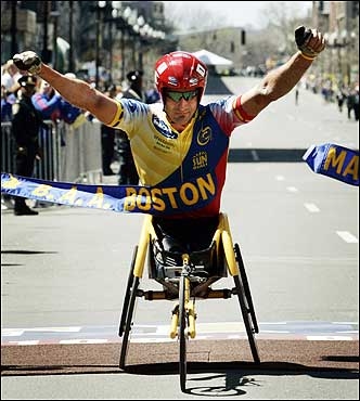 Defending Boston Marathon men's wheelchair champion Ernst Van Dyk of South Africa crossed the finish line to win. His time was 1:24:11.