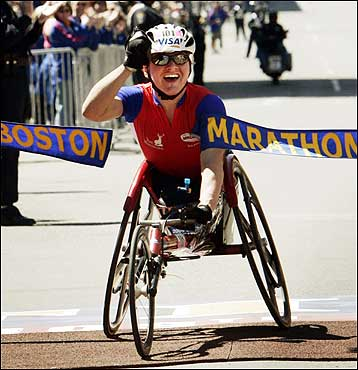 Defending Boston Marathon women's wheelchair champion Cheri Blauwet of Menlo Park, Calif., crossed the finish line to win. Her time was 1:47:45.