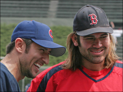 Nomar Garciaparra laughs with Johnny Damon before their interleague game at Wrigley Field.