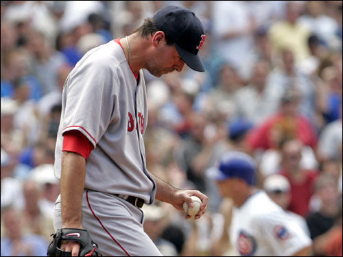 Red Sox relief pitcher John Halama reacts to giving up a two-run home run to the Cubs' Jeromy Burnitz during the sixth inning.